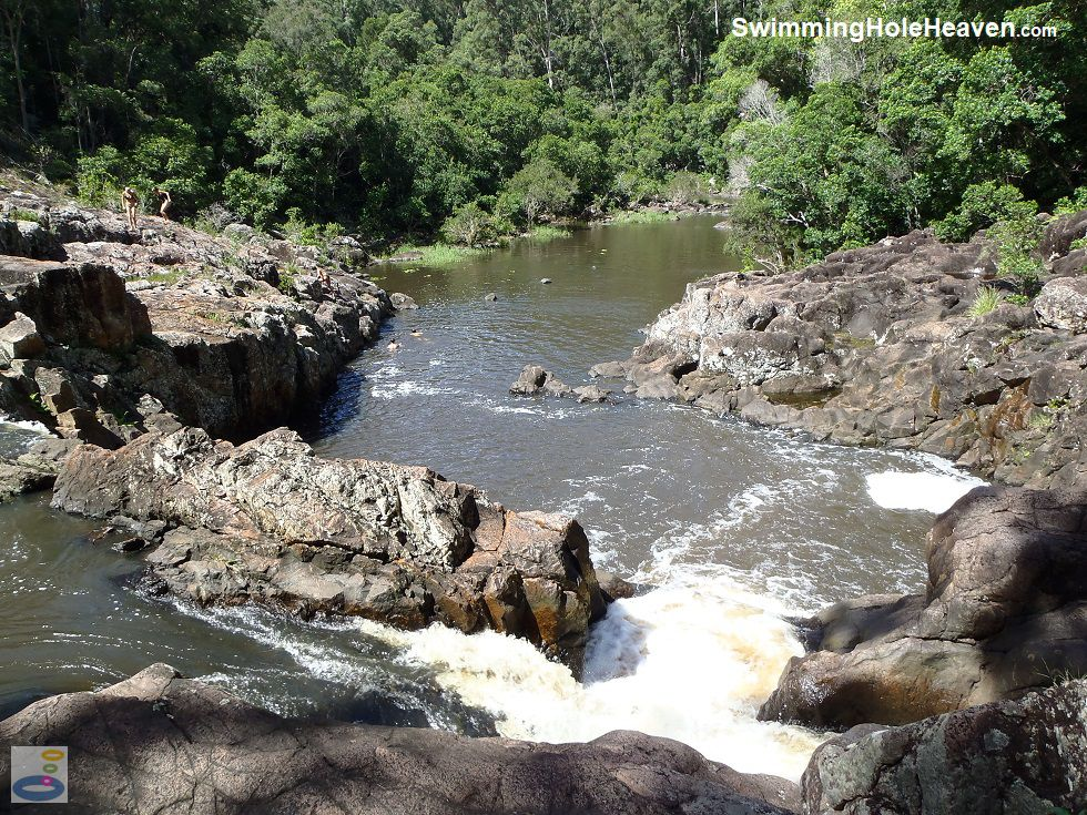 Swimmers in the calmer water downstream and heading back up to the rock ledges at Wappa Falls